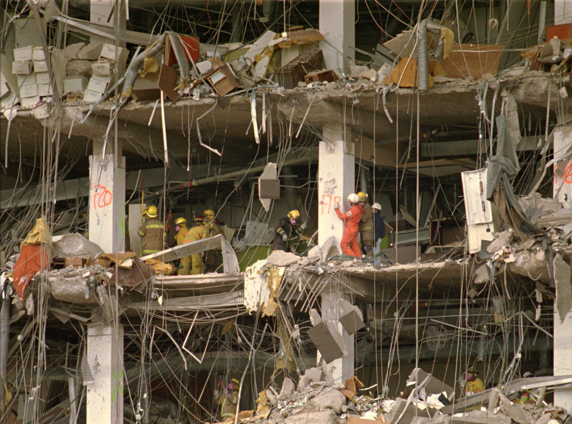 Rescue workers climb around the debris at the Alfred P. Murrah Federal Building searching for victims of the deadly truck-bomb blast in Oklahoma City in this April 23, 1995, file photo. Timothy McVeigh was found guilty in the Oklahoma City bombing that killed 168 people. He was executed May 16, 2001, at the U.S. Penitentiary in Terre Haute, Indiana.