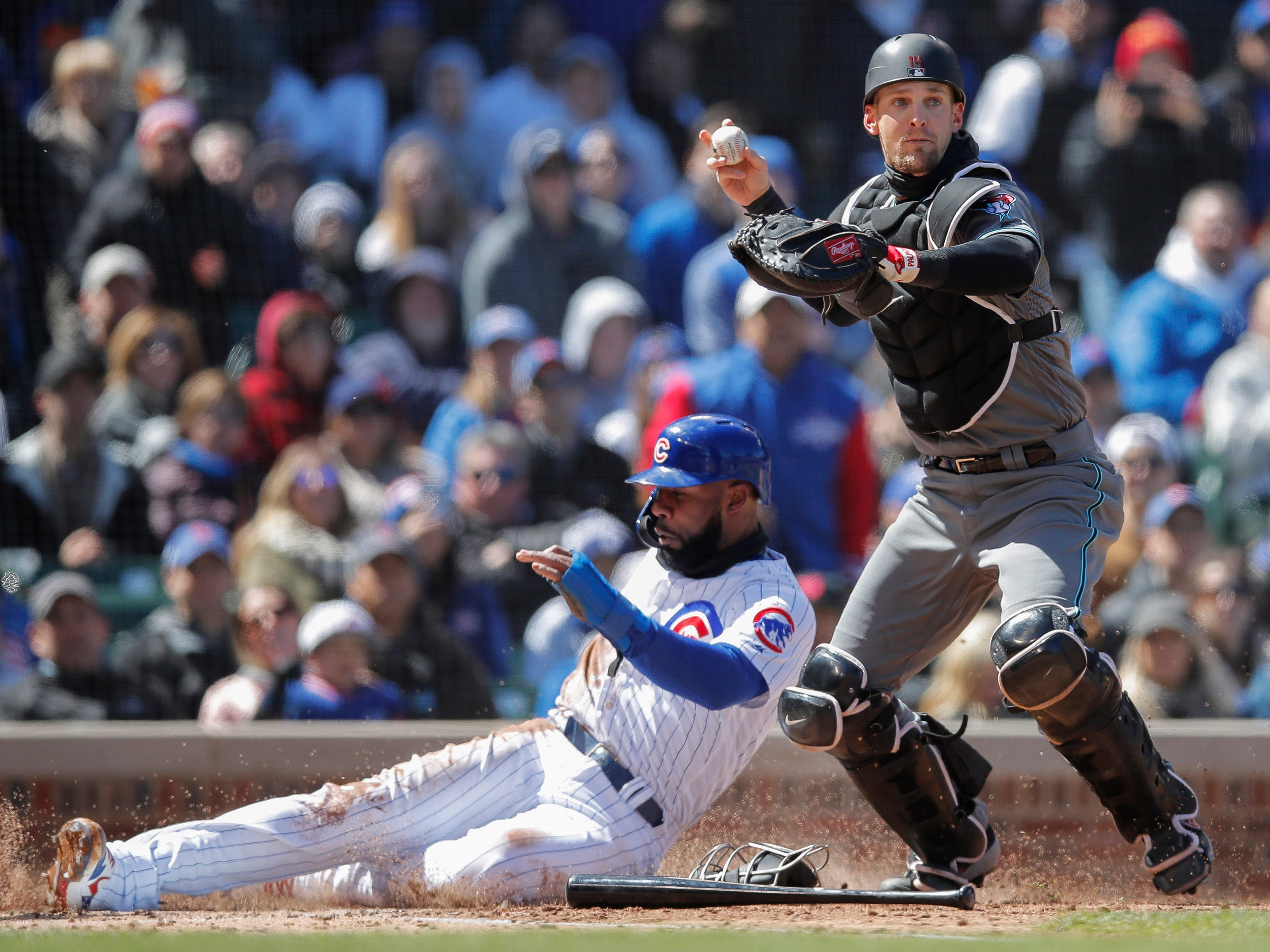 Cubs right fielder Jason Heyward is called out at home plate behind Diamondbacks catcher Caleb Joseph during the second inning of a game April 19 at Wrigley Field.
