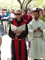 Fr. Micah Muhlen, OFM, read aloud scripture passages from gospels related to the death of Jesus at Friday's event.