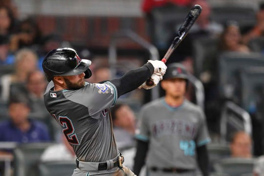 Diamondbacks first baseman Christian Walker drives in a run against the Braves during the seventh inning of a game April 16 at SunTrust Park.
