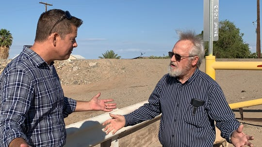 Yuma resident Dennis Cook (right) explains his frustration with illegal immigrants to U.S. Rep. Sean Duffy, R-Wis.