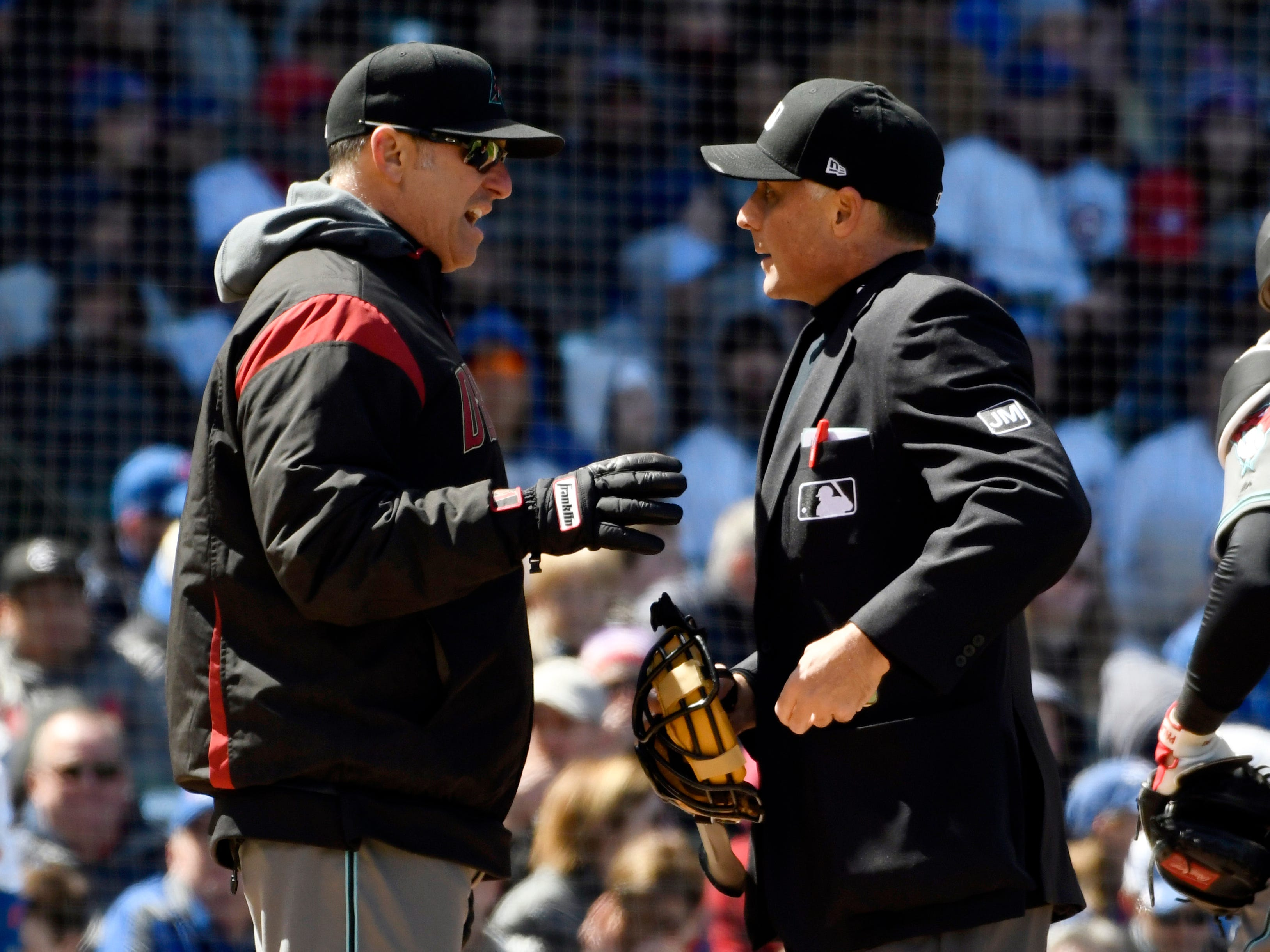 Arizona Diamondbacks' manager Torey Lovullo, left, questions a call with umpire Dan Iassogna (58) during the second inning of a baseball game against the Chicago Cubs, Friday, April 19, 2019, in Chicago. (AP Photo/David Banks)