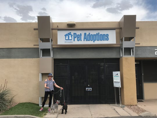 Annie Czenszak stands with her dogs, Baloo and Chiquita, outside Lost Our Home Pet Rescue in Tempe, AZ. Her dogs are part of the shelter's temporary care program.
