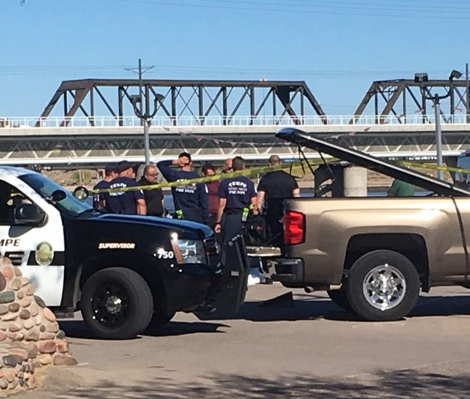 Police investigate a man's body found at Tempe Town Lake on April 19, 21019.