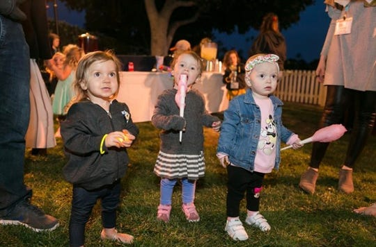 Stella Miller, left, a 2-year-old from Port Clinton diagnosed with a rare disease, cystinosis, enjoys some treats at the 2019 Cystinosis Research Foundation Day of Hope Family Conference in Newport Beach, California.