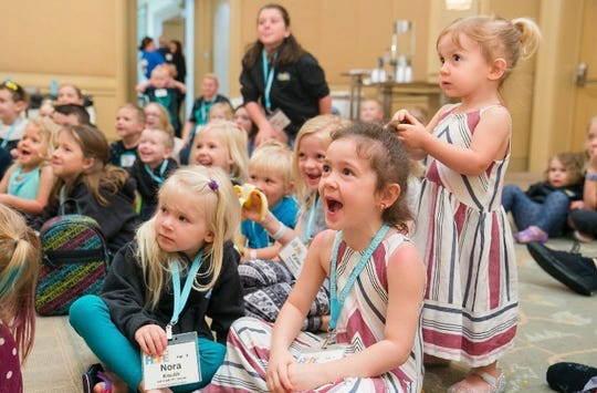 Stella Miller, right, and her sister, Vada, look on with excitement during a children's event at the 2019 Cystinosis Research Foundation Day of Hope Family Conference in Newport Beach, California.