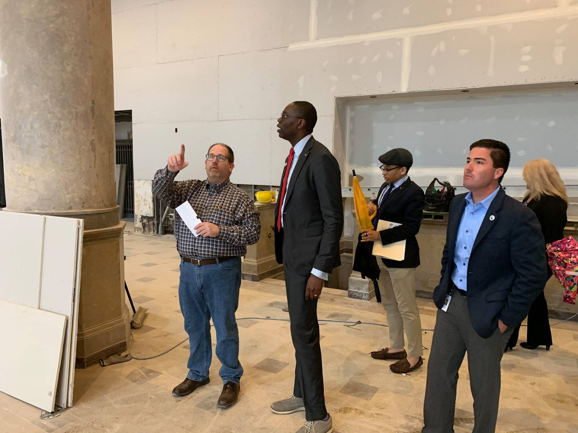 Scott Beedon, left, points to areas around the developing ballroom at the CityFlats Hotel to Lt. Gov. Garlin Gilchrist on Friday, April 12, 2019. Port Huron City Manager James Freed, right,  posted the photo to share Gilchrist's visit on social media. The ballroom, particularly, is being kept close to the vest by development officials until after it debuts at a May 10 event.