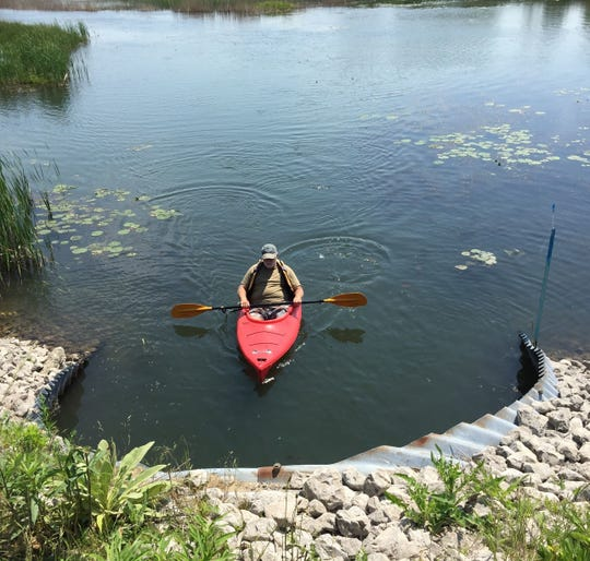 A paddler prepares to enter a culvert carrying the Krispin Blueway under a roadway on Harsens Island in 2017.