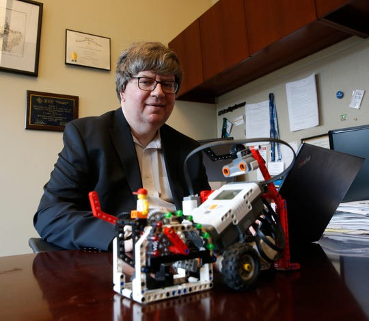 Casimer DeCusatis in his office at Marist College in Poughkeepsie on April 19, 2019. DeCasatis, a cybersecurity professor founded the Hudson Valley FIRST LEGO League in 2007.