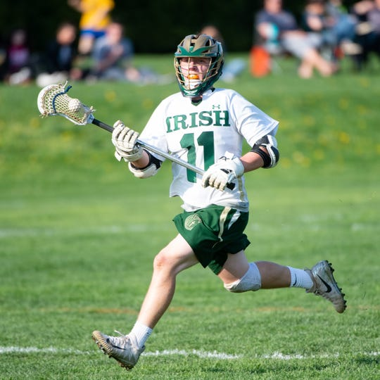 Drew Snelbaker (11) runs the field during the boys' lacrosse game between York Catholic and York Suburban, April 18, 2019 at York Catholic High School. The Fighting Irish defeated the Trojans 22 to 3.