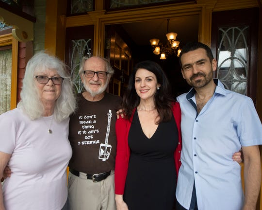 From left: Jean Leaman and Jim Leaman stand with new owners Laura Heydt and Lukasz Szyrner.