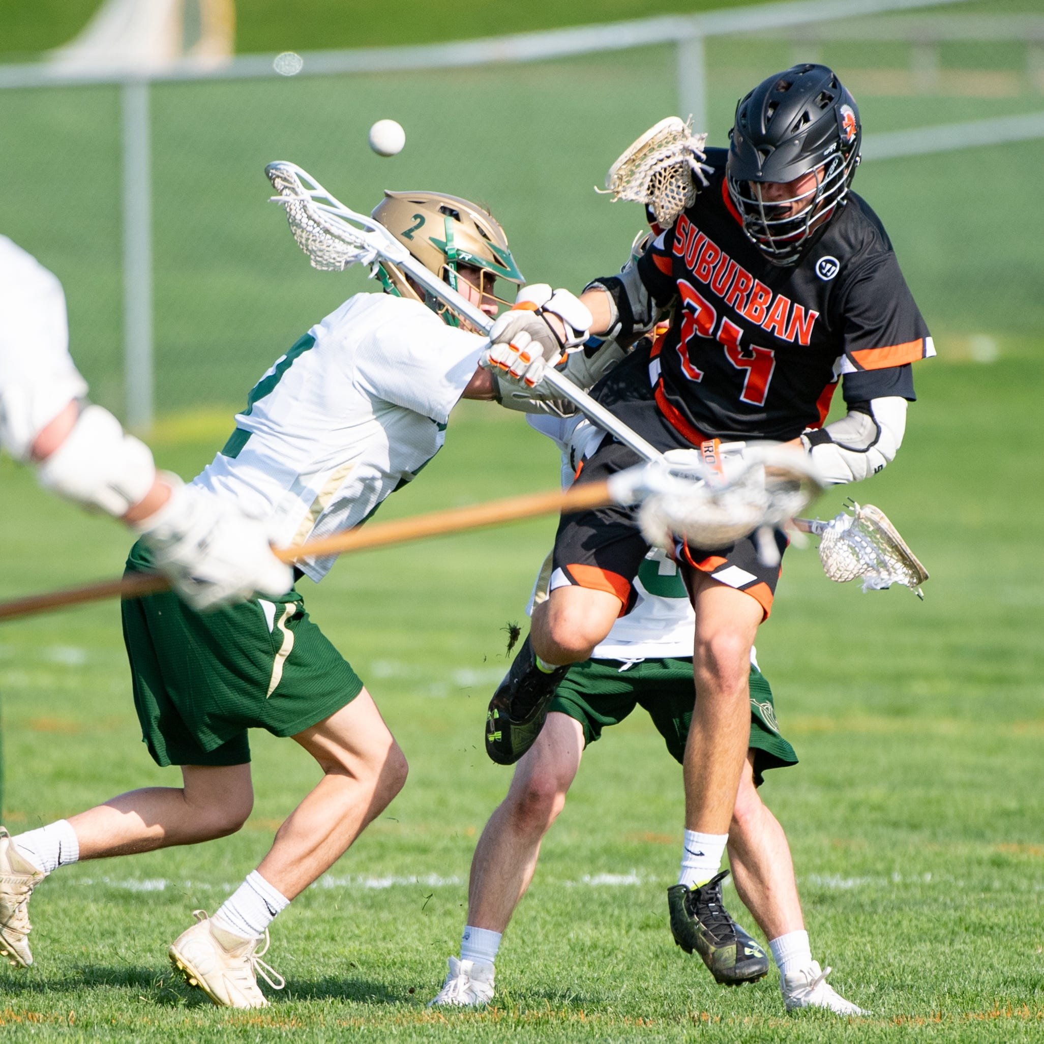 Johnny Wasilewski (24) gets pushed during the boys' lacrosse game between York Catholic and York Suburban, April 18, 2019 at York Catholic High School. The Fighting Irish defeated the Trojans 22 to 3.