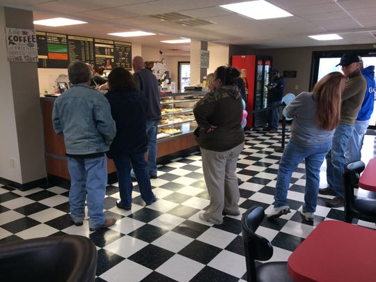 Customers lined up Friday morning at Bismarck Donuts on North West Fifth Street.