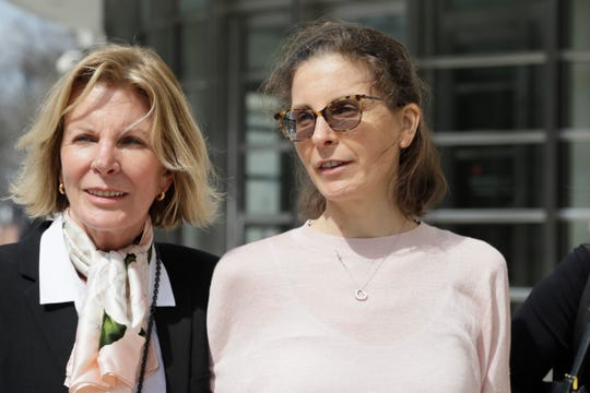 Clare Bronfman, right, a member of NXIVM, an organization charged with sex trafficking, leaves Brooklyn Federal Court, Monday, April 8, 2019, in New York. Jury selection is set to begin Monday for the trial, expected to detail sensational allegations that a cult-like group based in upstate New York recruited sex slaves for its spiritual leader. (AP Photo/Mark Lennihan)