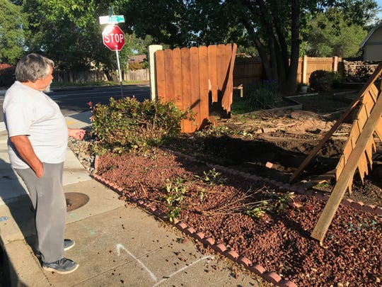 John Bourdon surveys his wrecked backyard fence at the corner of Victor Avenue and Vega Street where a suspected drunken driver smashed through it early Friday, April 19, 2019.