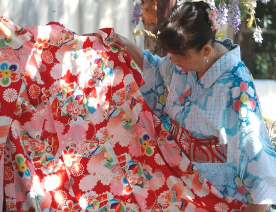 Vicki Ono of the Japan Society of Shasta County displays a kimono in advance of the Cherry Blossom Festival set for Saturday, April 27, 2019, at Sequoia Middle School in Redding.