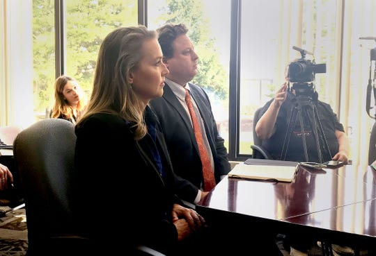 Former Oregon First Lady Cylvia Hayes and her attorney Josh Ewing appear before the Oregon Government Ethics Commission on Friday. The commission approved a $50,000 settlement with Hayes in her ethics case. She won't pay all of the $50,000 because of a pending bankruptcy case.