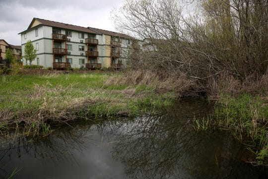 Hawk's Ridge apartment complex, recently built on mitigated wetlands, is pictured in Salem on April 19, 2019.