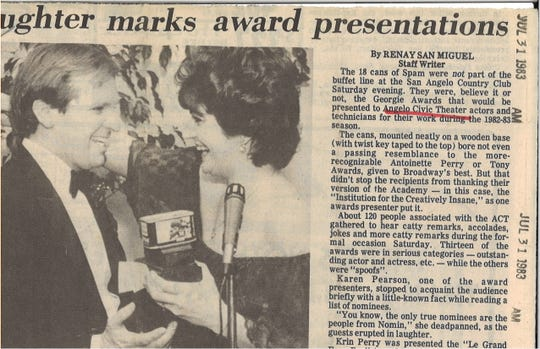 Actor Alan Dean accepts the Georgie Award for Best Actor in a Drama from award presenter Karen Pearson, in this July 31, 1983 photo. This was the first year of the Georgia Awards, where they were presented cans of Spam.