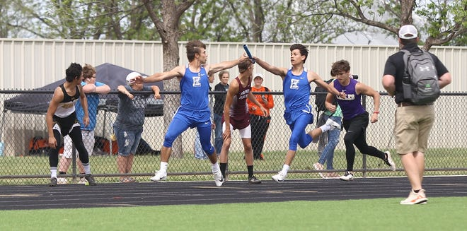 Eden High School's Eli Eureste, right, hands off to Austin Moya during the boys 4x200-meter relay at the Districts 11&12-1A Area Track and Field Meet Tuesday, April 16, 2019, in Sterling City.