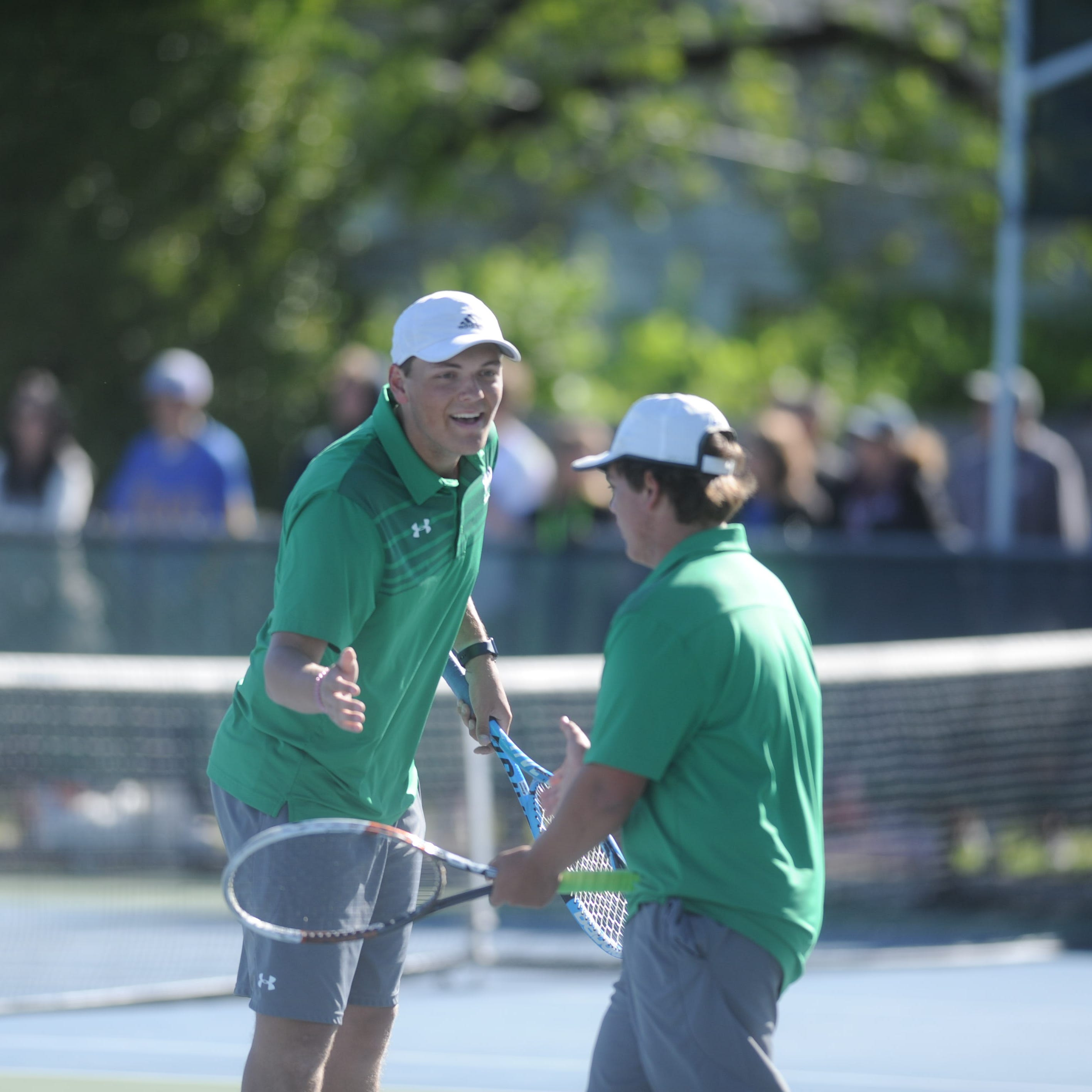 Wall, Brady defend regional tennis titles