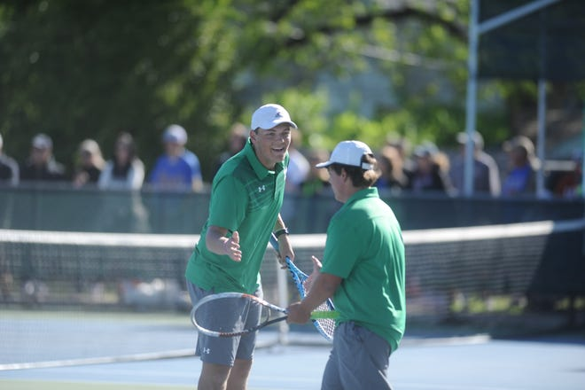 Wall's Colton Chitsey (left) celebrates with Shawn LaBedelle after a point. They defended their title in boys doubles at the Region I-3A Tournament at Rose Park Tennis Center in Abilene on Friday, April 19, 2019.
