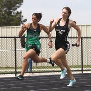 Water Valley High School's Kenzie Jordan, right, runs with the baton on the final leg of the girls 4x200-meter relay, getting the inside-lane edge against Blackwell's Vickie Davis at the Districts 11&12-1A Area Track and Field Meet Tuesday, April 16, 2019, in Sterling City.