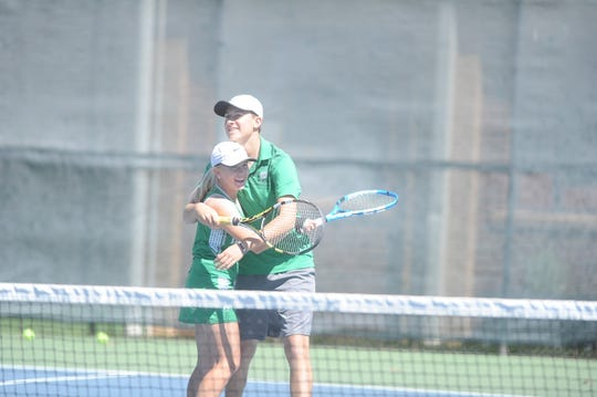 Wall's Carson Watts (left) and Mark Holtman celebrate after winning the mixed doubles title at the Region I-3A Tournament at Rose Park Tennis Center in Abilene on Friday, April 19, 2019.