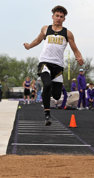 Menard High School's Kallin Kothmann competes in the boys triple jump at the Districts 11&12-1A Area Track and Field Meet Tuesday, April 16, 2019, in Sterling City.