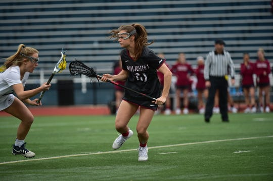 Stephen Decatur grad and Saint Joseph's defender Ally Beck defends against Villanova.