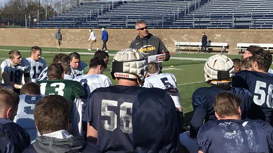 Augustana coach Jerry Olszewski recaps practice with his players Thursday at Kirkeby Over Stadium