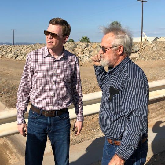 Rep. Dusty Johnson talks to a landowner near the U.S.-Mexico border earlier this week.