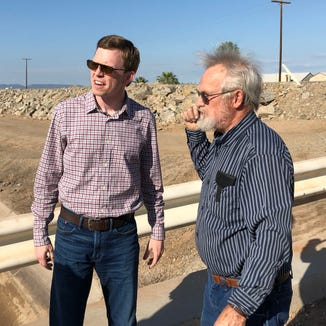 Rep. Dusty Johnson talks to a landowner near the U.S.-Mexico border earlier this week.