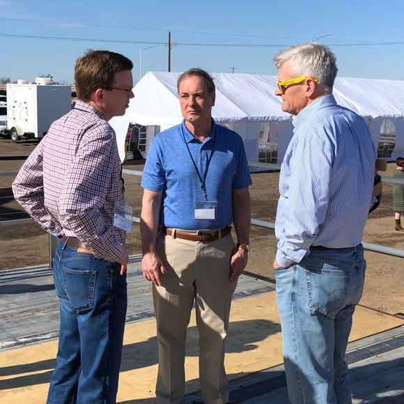 Dusty Johnson speaks with Sen. Bill Cassidy of Louisiana and Rep. John Joyce of Pennsylvania during the border trip.