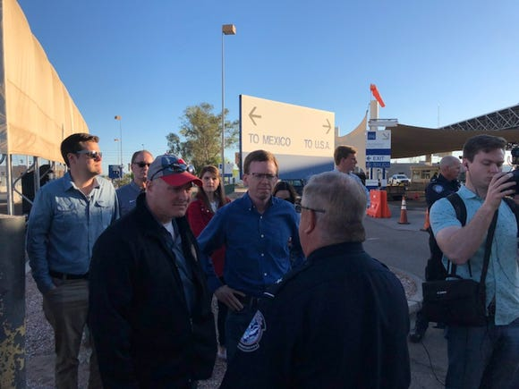 Dusty Johnson is joined by other congressional members talking to the port director at San Luis.