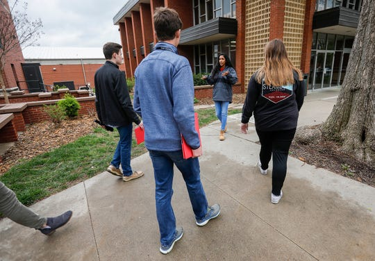 Velona Tawfik, center, a junior at Drury University, leads a tour of campus for prospective students on Thursday, April 18, 2019.