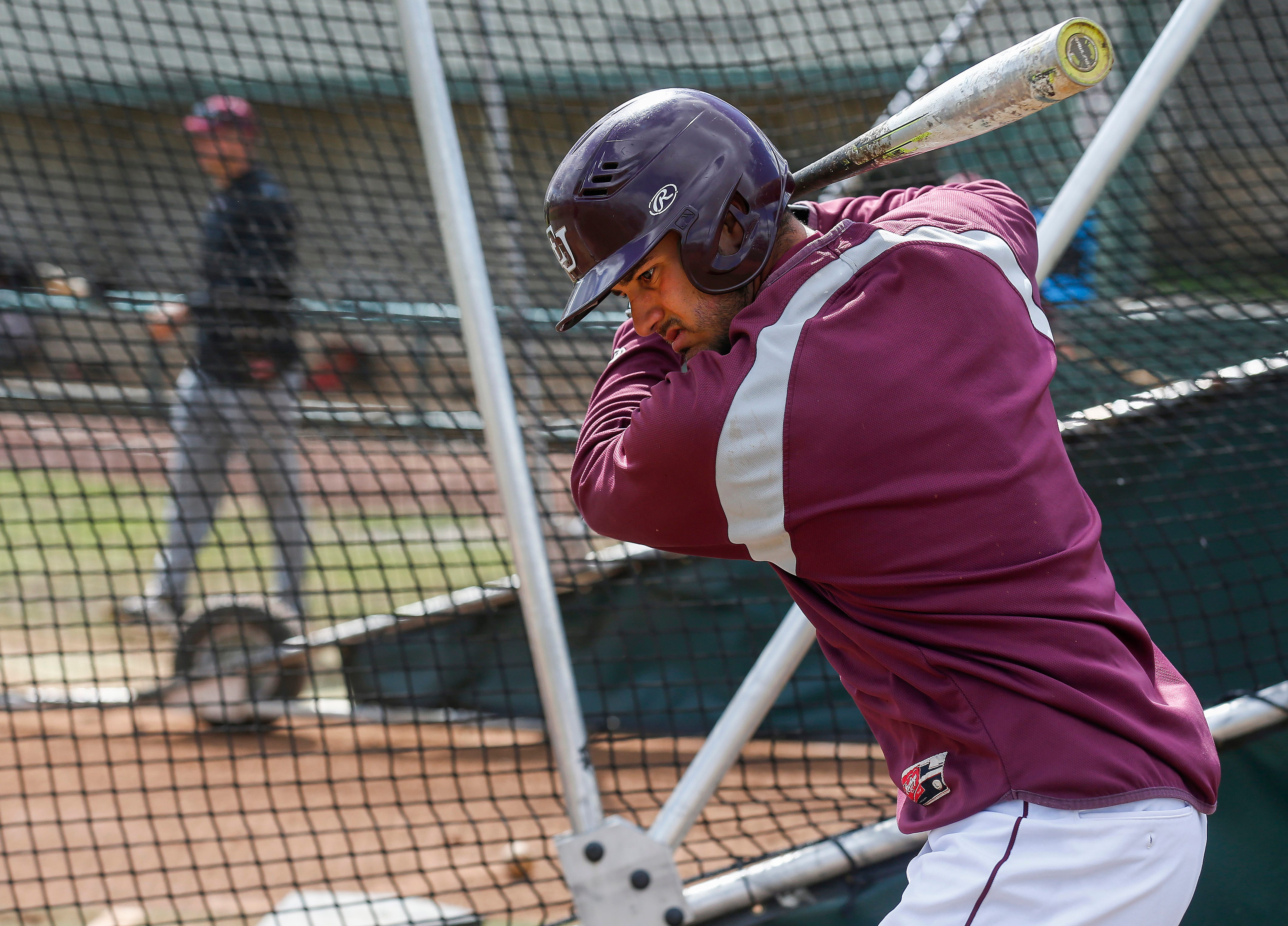 Jose Vargas, a shortstop at Evangel University, gets ready for batting practice before a double-header on Friday, April 19, 2019. Vargas, a senior, is stuck in limbo because of what is happening in his home country of Venezuela.