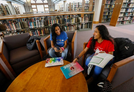 Velona, right, and Verna Tawfik, twin sisters from Egypt who are juniors at Drury University, study in the library on Thursday, April 18, 2019.