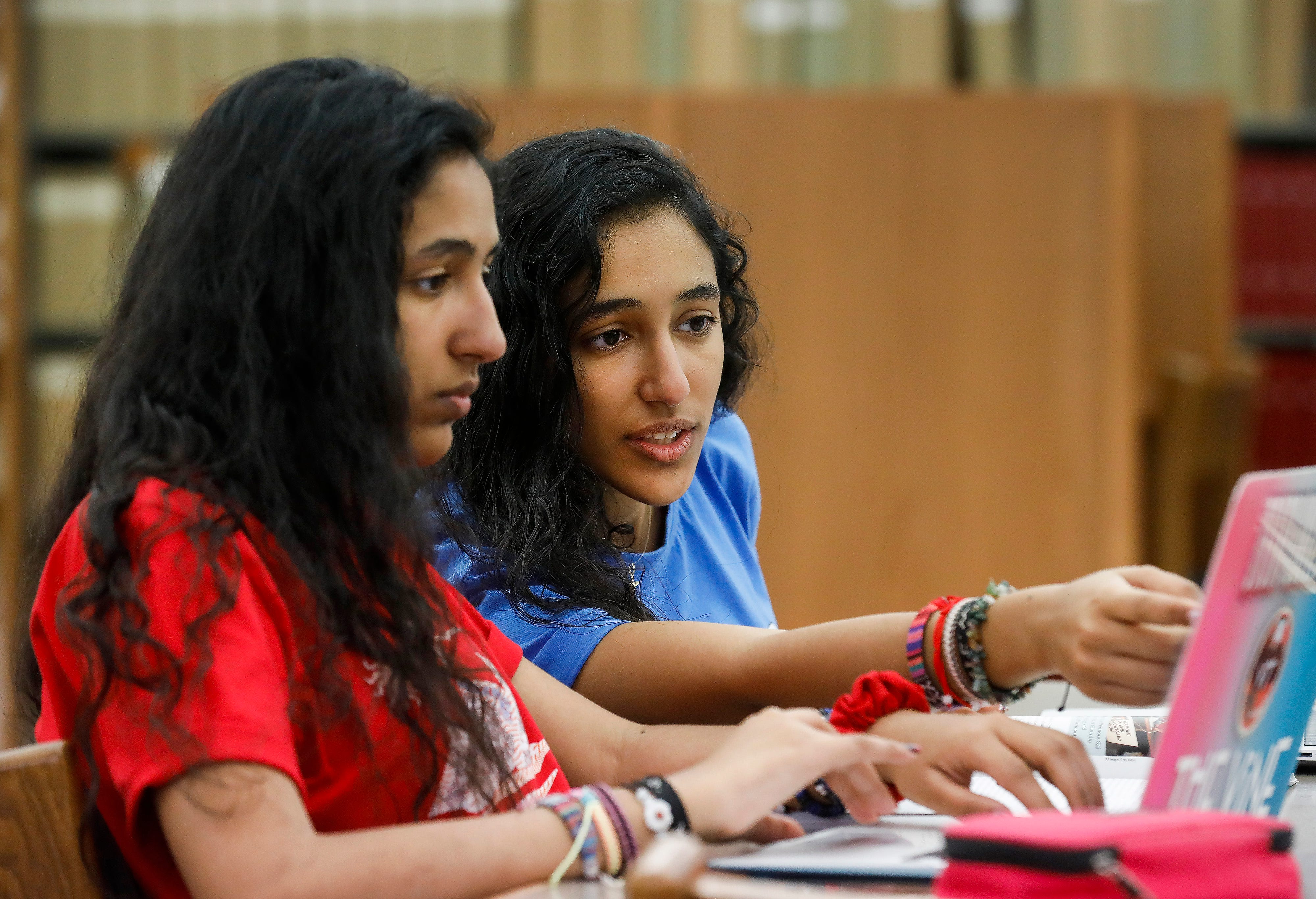 Velona, left, and Verna Tawfik, twin sisters from Egypt who are juniors at Drury University, study in the library on Thursday, April 18, 2019.