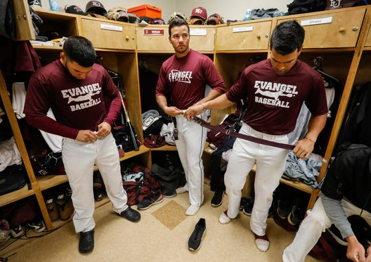 Jose Vargas, center, a shortstop at Evangel University, and his teammates Rafael Rodriguez, left, and Harold Alvarez get ready for a double-header on Friday, April 19, 2019. Vargas, a senior, is stuck in limbo because of what is happening in his home country of Venezuela.
