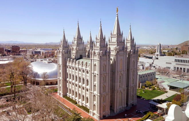 In this Thursday, April 18, 2019, photo, shows the Salt Lake Temple, in Salt Lake City. An iconic temple central to The Church of Jesus Christ of Latter-day Saints faith will close for four years to complete a major renovation, and officials are keeping a careful eye on construction plans after a devastating fire at Notre Dame cathedral in Paris. (AP Photo/Rick Bowmer)
