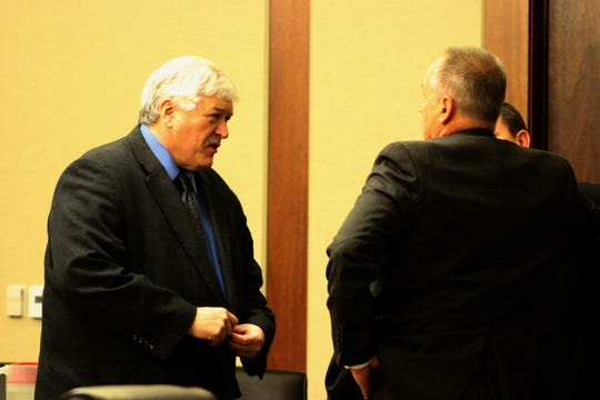 From left, defense attorney Edward Flint and Deputy County Attorney Zach Weiland speak during a break in the murder trial for Kevin Ray Mcatlin.