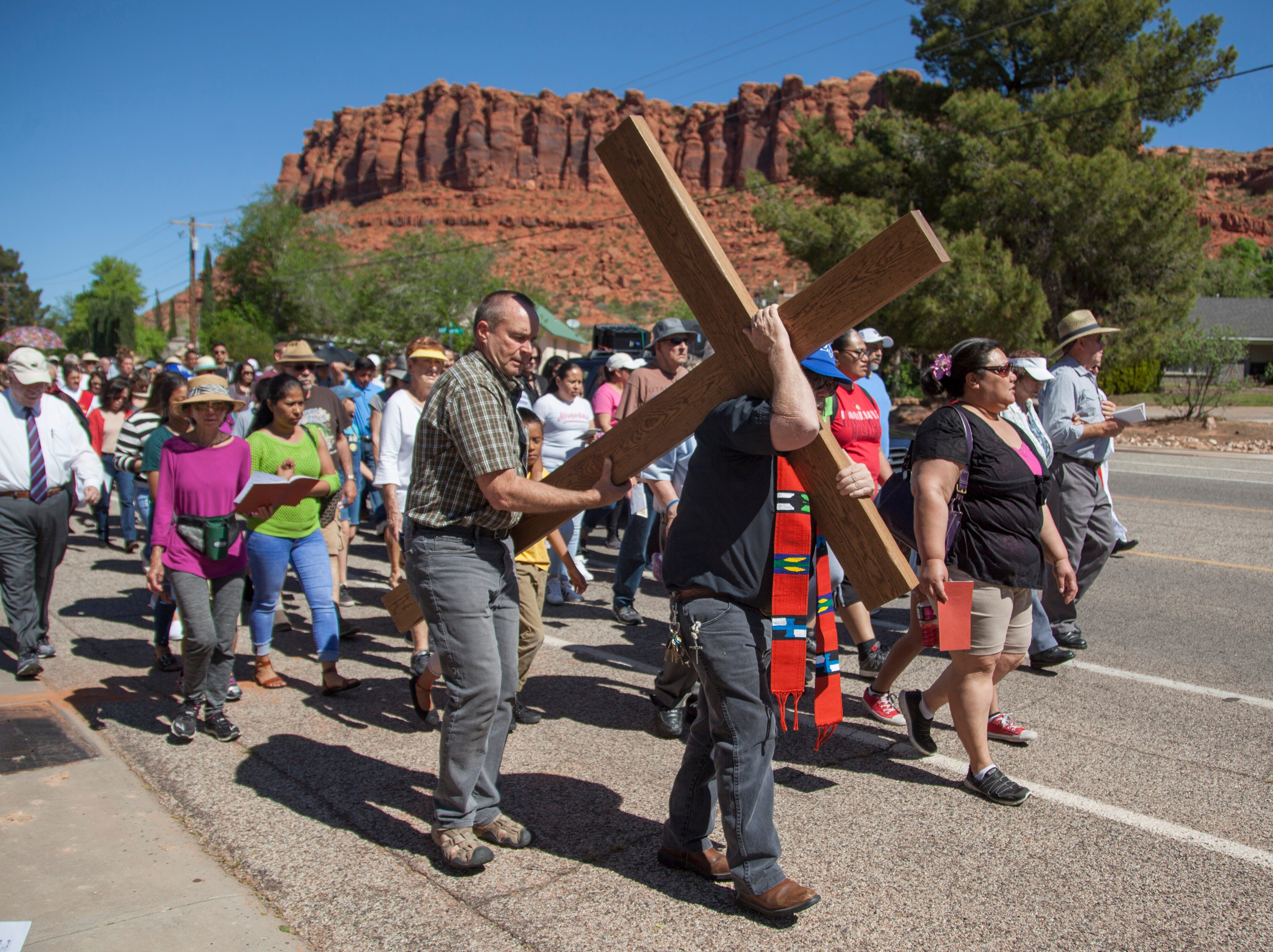 Christians from various groups gather at Sandtown Park for the annual Ecumenical Way of the Cross Friday, April 19, 2019.