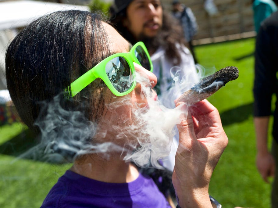 "FILE - In this Friday, March 22, 2019 file photo, a participant takes a very smoky puff from a marijuana cigarette during at meet and greet at ""Tommy Chong's Live, Love, and Smoke Tour hosted by GreenTours in the Woodland Hills section of Los Angeles. U.S. retail sales of cannabis products jumped to $10.5 billion last year, a threefold increase from 2017, according to data from Arcview Group, a cannabis investment and market research firm. The figures do not include retail sales of hemp-derived CBD products. (AP Photo/Richard Vogel, File)"