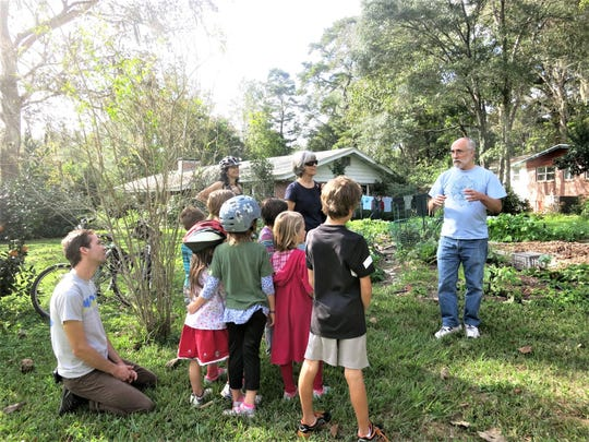 Arborist David Copps explaining tree health at Indianhead-Lehigh.