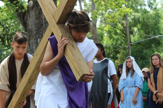 Every year Trinity Catholic Schooleighth graders participate in a reenactment of the Passion of Christ during Holy Week.