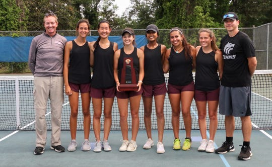 Chiles' girls tennis team captured its fifth straight District 2-3A championship on Thursday at Tom Brown Park. From left: Timberwolves assistant coach Allen Long, Harli Neshat, Amy Xia, Gracie Wilson, Rasee Bhoola, Sofia Guerrero, Savanna Phelps, head coach Mike Dross.