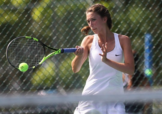 St. John Paul II senior Sara Grace Rooney plays in the District 2-1A tennis tournament at Maclay School on April 16 and 17, 2019.