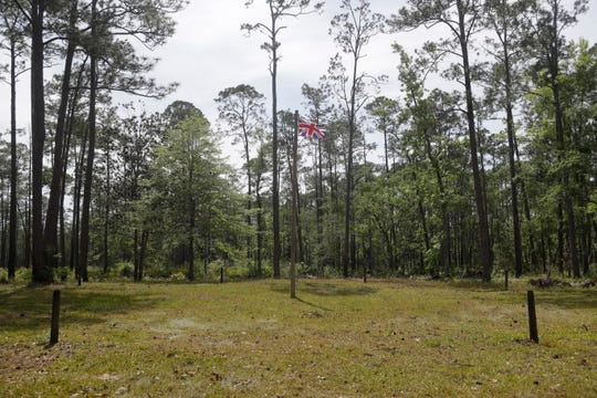 Wooden posts surrounding a British flag mark what was once the outside wall of the Negro Fort that stood at Prospect Bluff in the Apalachicola National Forest Wednesday, April 17, 2019.