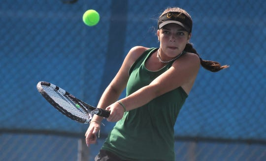 Lincoln senior Kailey Williams plays during the District 2-3A tennis tournament at Tom Brown Park on April 17 and 18, 2019.